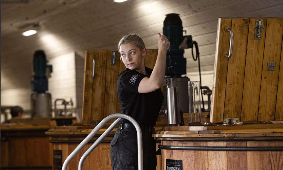 Iona Macphie working at the washback at Torabhaig.