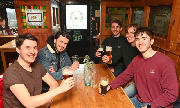 Pubs open again and the high street picks up in Inverness today! Picture: L2R - Friends from Nottingham visit the Highlands and are pictured inside pub - Johnny Foxes Daniel Pritchard, Sam Gillingham, Luke Northbrooke, Jacob Hawkins, Mark Gillingham
