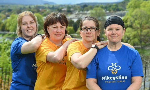 Prisoner custody officers Kailey Macwilliam, Fiona Clark, Martine Bushell and Andrea Stewart are donning their running shoes in aid of Highland Hospice and Mikeysline