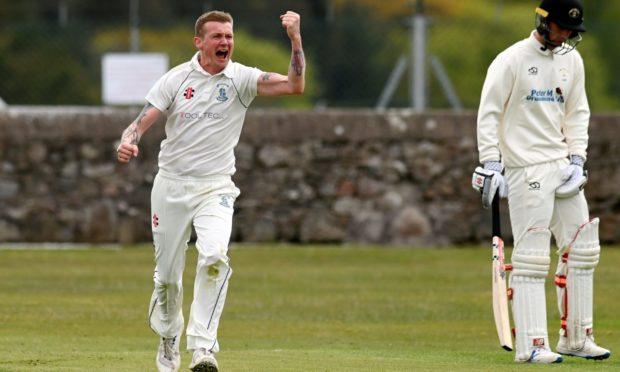 Stoneywood-Dyce bowler Jon Grant celebrates.