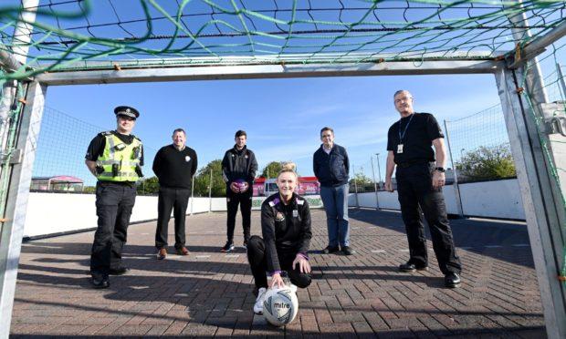 Sgt John McOuat, Stuart Neil of Tesco, Fraser Burnett and Aimee Culley of Street Sport, Cllr Steve Delaney and PC Derek Bain.