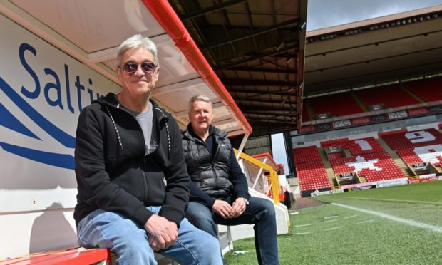 Eddie McCluskey, left, who is visiting every Scottish football ground for an Alzheimer's charity, met up with former Aberdeen defender Willie Garner at Pittodrie.