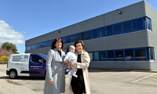 Co-founder Michelle Herd, founder Danielle Flecher-Horn and little Albie Horn outside the AberNecessities headquarters on Howe Moss Road, Dyce. Picture by KATH FLANNERY