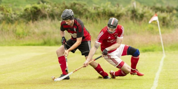 Andrew MacCuish tries to get away from Conor Cormack of Kinlochshiel.
