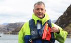 Loch Duart health and safety manager David McKeown wearing the new POB System.