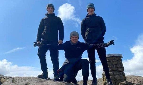 To go with story by Ellie Milne. Luke Mackie is climbing Bennachie 17 times in 48 hours to raise money for Cancer Research UK.  Picture shows; Luke Mackie and his friends Craig and Fraser Scott. Bennachie. Supplied by Adrienne Mackie Date; 05/05/2021