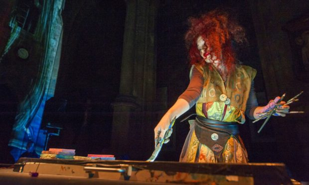 Multi-media artist Maria Rud creating imagery at St Giles Cathedral.