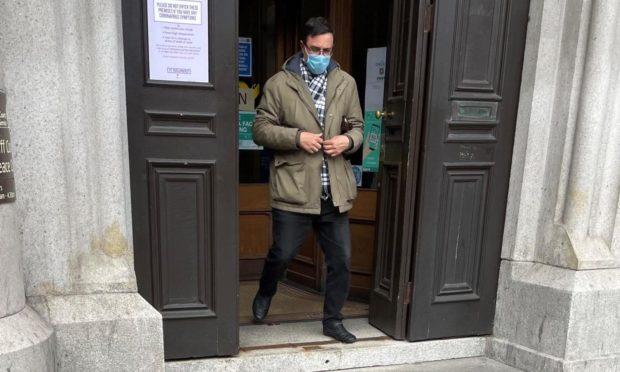 Menshykov leaving court.