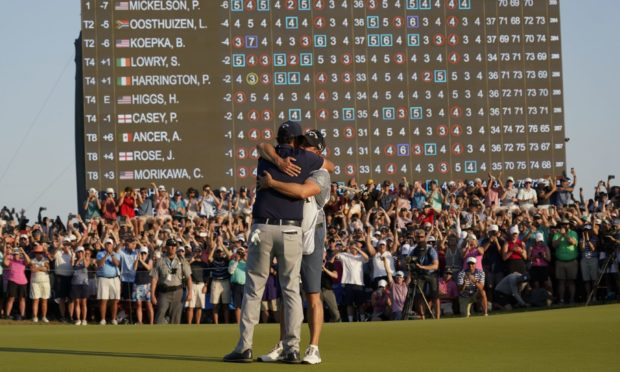Phil Mickelson celebrates with his caddie and brother Tim after winning the final round at the PGA Championship golf tournament on the Ocean Course, Sunday, May 23, 2021, in Kiawah Island, S.C. (AP Photo/Chris Carlson)
