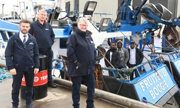 Fisherman's Mission Superintendants: Kenny Brandie, Sandy Garvock and Miriam Kemp with Ghanaian crew members from the Fruitfull Bough in Peterhead Harbour.