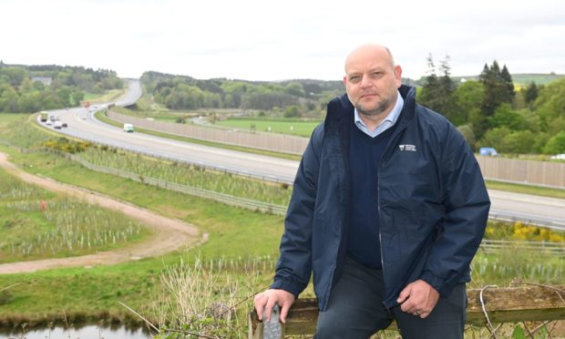 Iain Hawkins, of the National Trust For Scotland, wants brown tourist route signs put up on the AWPR to highlight the charity's attractions - and other around the area - to visiting motorists.