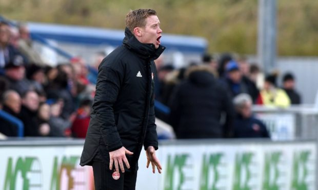 Aberdeen U18 coach Barry Robson cheers on the young Dons.