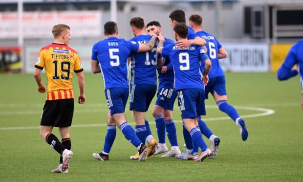 Cove Rangers players congratulate Rory McAllister on leveller.