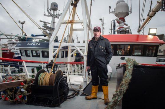 Pictures by JASON HEDGES     Skipper John Clark Pictures by JASON HEDGES