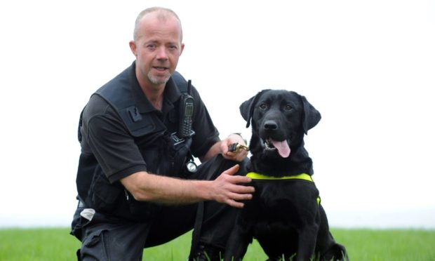 George Shearer was serious injured in the crash and police dog Sam had to be put down