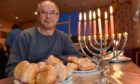 The Jewish community in Aberdeen are unable to have their Hanukkah celebration at their synagogue this year as it's still closed due to flood damage.  The congregation of Summerhill Church have kindly let them use their hall this year for their festivities. Picture of Mark Taylor (head of Aberdeen Synagogue) with the Menorah.   Picture by KENNY ELRICK     17/12/2017