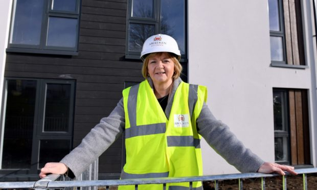 Council leader Jenny Laing's Aberdeen Labour group pledged to build 2,000 new council houses in the city within the council terms