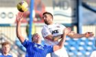 Cove Rangers defender Scott Ross, right, in action against Peterhead.