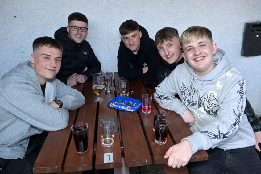 (From left): Liam McDade, Daniel Rae, Kammy Cochrane, Connor Bunce and Euan Cameron in the Innes Bar, Innes Street.