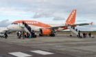 EasyJet aircraft on the apron at Inverness Airport.