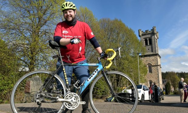 Reverend Andrew Kimmitt of Aberlour passes through the village on Saturday afternoon on the last leg of his one day run, cycle and kayak from Loch Spey to the rivers mouth at Spey Bay in aid of Christian Aid.