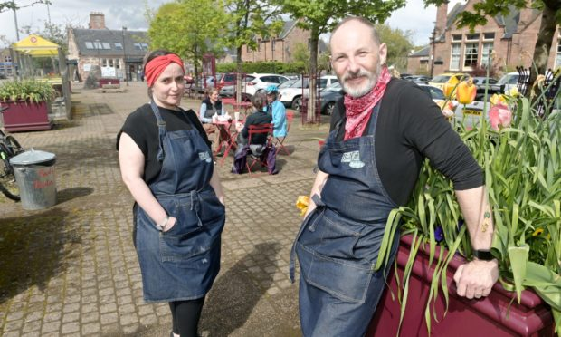 Jeni and Douglas Hardie of Bad Girl Bakery in Muir of Ord are concerned over the removal of an area in the centre of the village currently used for outdoor seating and eating.