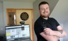 Conor Ferguson wants to take his improving darts form into the local leagues after sharpening up virtually.  Picture by Sandy McCook