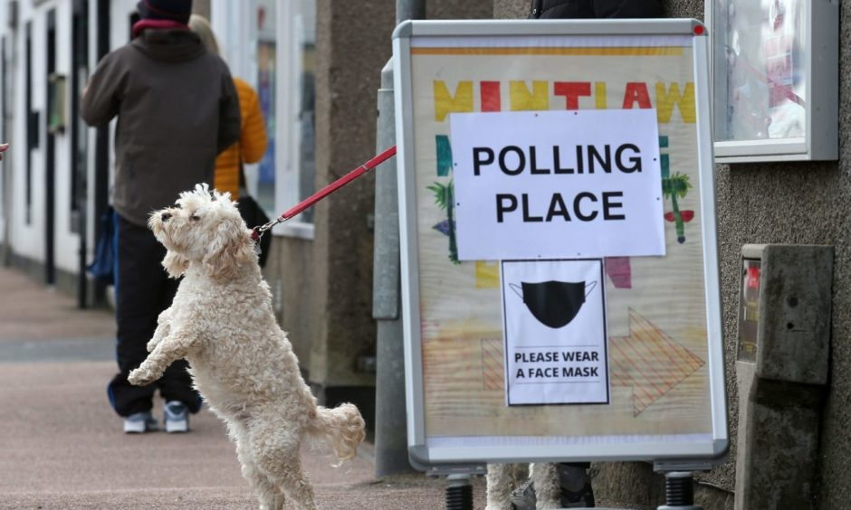 A dog waits outside a polling station in Mintlaw, Aberdeenshire.  Photograph by Andrew Milligan/PA Wire