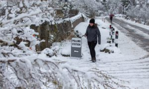 A voter goes to the polls in Farr, near Inverness. PIcture: Paul Campbell/PA Wire