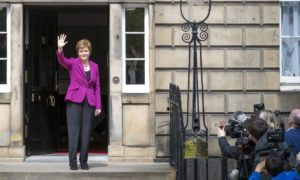 Crest of a wave: First Minister Nicola Sturgeon enters a new Holyrood term with a packed slate.