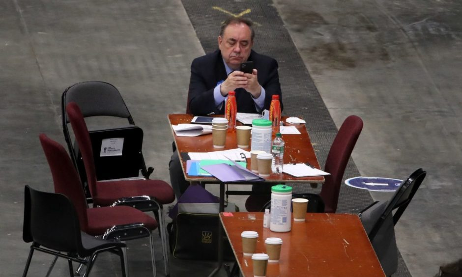 Alba party leader Alex Salmond on his phone as votes are being counted for the Scottish Parliamentary Elections at the P&J Live/TECA, Aberdeen. Picture date: Friday May 7, 2021. PA Photo. See PA story POLITICS Elections. Photo credit should read: Andrew Milligan/PA Wire