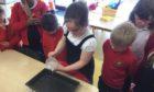 Schoolchildren working on the project