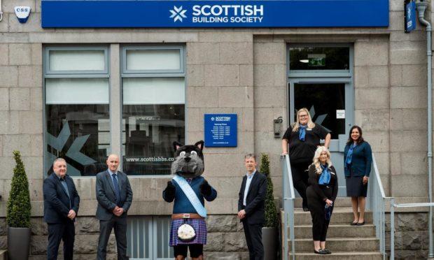 The SBS Aberdeen team launch the new branch. (L to R) Paul Denton, Alan Chapman, SBS mascot Hamish, Douglas Sharpe, Samantha Bain, Mhari Crawford and Reena Bell.