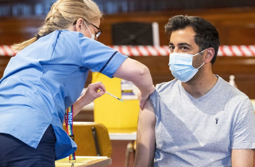 Health secretary Humza Yousaf receives his coronavirus vaccine at the Caird Hall in Dundee