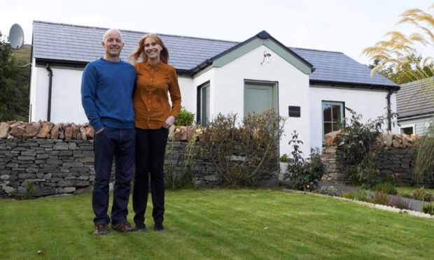 Julie Talbot and her partner Gary of Evrabister in Shetland. Supplied by BBC Scotland / IWC Media
