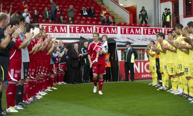 Aberdeen's Darren Mackie receives a   warm welcome from the crowd in his testimonial.