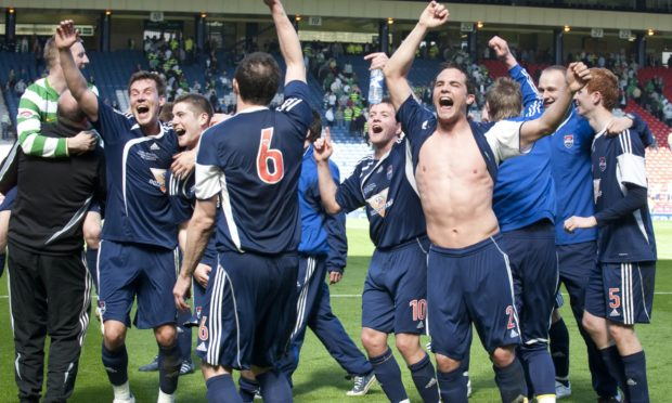 Ross County players celebrate after beating Celtic in the 2010 Scottish Cup semi-final.