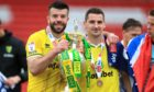 Norwich City's Scotland pair Grant Hanley (left) and Kenny McLean pose with the Championship trophy.