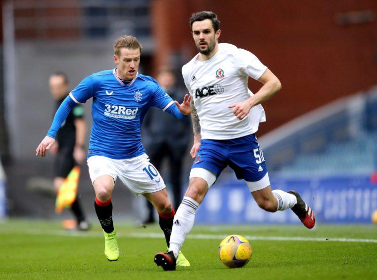 Cove Rangers' Scott Ross (right) in action against Rangers.