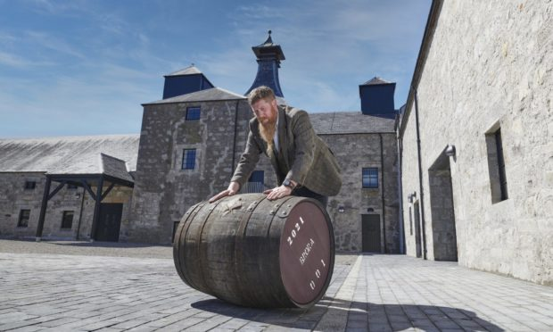 Master distiller Stewart Bowman filled the first cask of spirit to mark Brora Distillery's reopening.