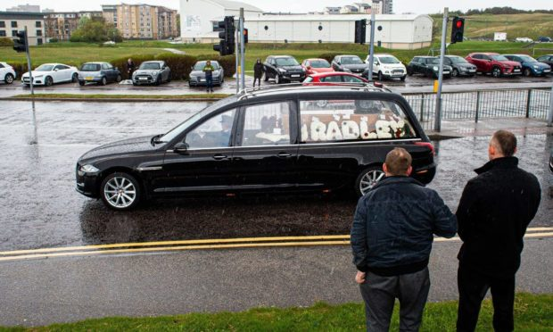 Funeral of Bradley Allan, the Anxiety Bloke, passes mourners lining the Beach Boulevard