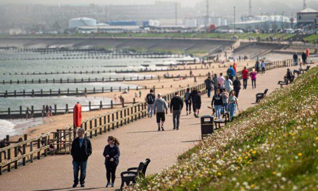 Locals headed to Aberdeen beach to catch the sun.