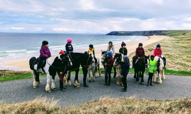 Traigh Mhòr Pony Trekking staff and members of its Junior Saddle Club.