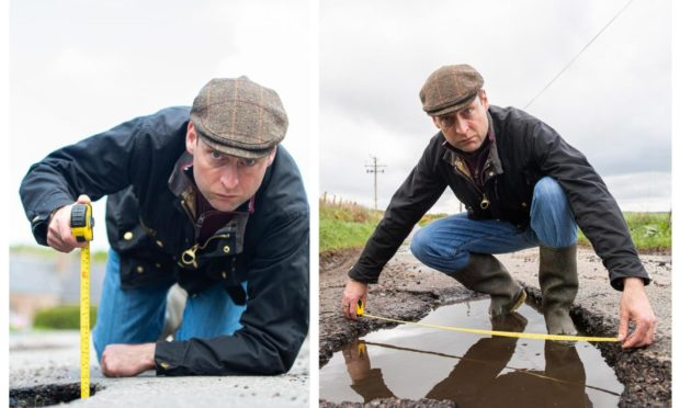 North-east MSP Liam Kerr demonstrating how large potholes are in the Netherley area.