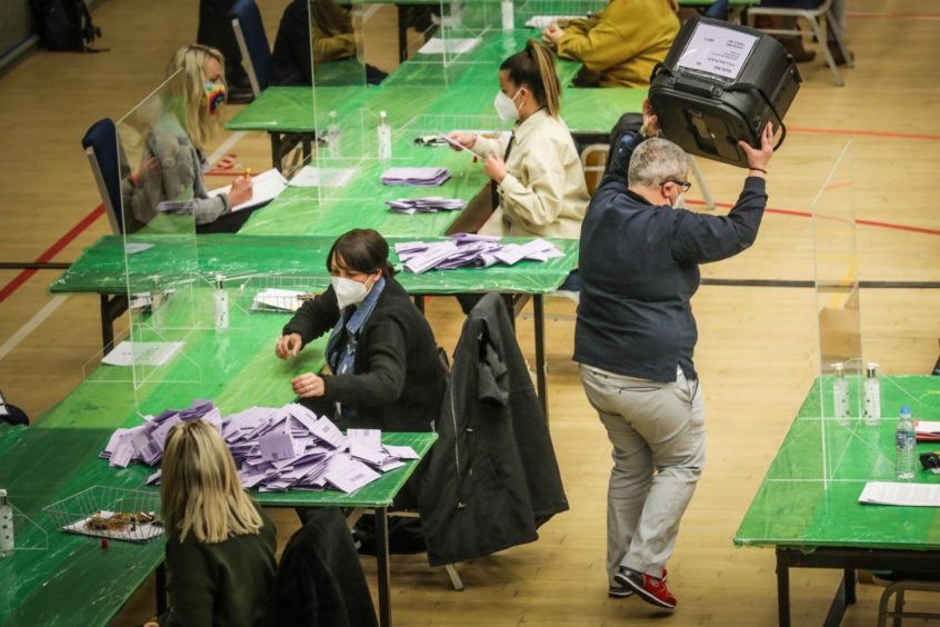 The Courier, CR0028093, News, Emma O'Neill story, the count has started at Dundee's DISC today for Dundee West. Picture shows; general shots of the first ballot boxes being tipped out as the count assistants start to do their bit. Friday 7th May, 2021. Mhairi Edwards/DCT Media