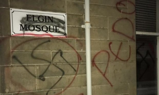 A swastika on the side of Elgin mosque