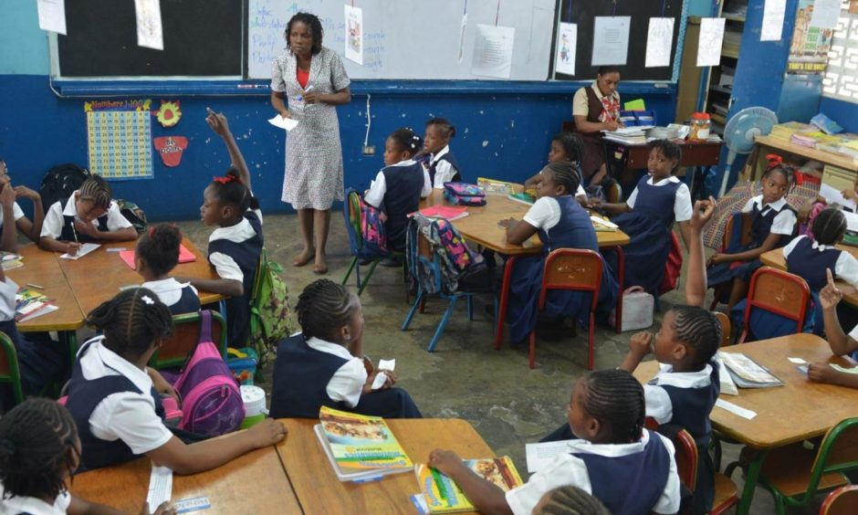 A teacher and her class at a primary school in Jamaica.