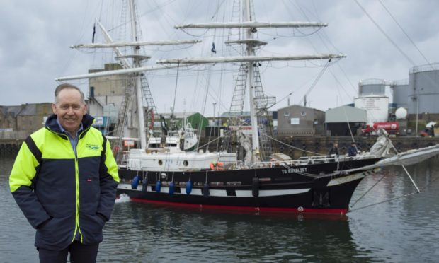 Peterhead Port Authority chief executive Simon Brebner, with Sea Cadets' ship TS Royalist behind him.