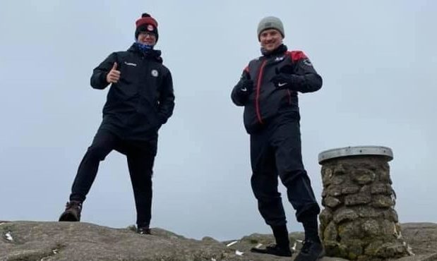To go with story by Ellie Milne. Luke Mackie is climbing Bennachie 17 time to raise money for Cancer Research UK. Picture shows; Luke Mackie and a friend at Bennachie. Bennachie. Supplied by Adrienne Mackie Date; 05/05/2021