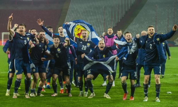 Scotland's players celebrate after David Marshall saves Aleksandar Mitrovic's penalty during the UEFA Euro 2020 play off final defeat of Serbia.